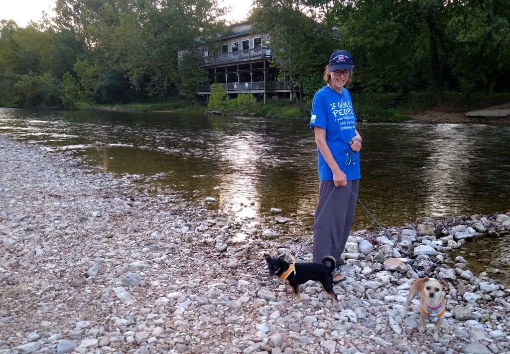 Sue and doggies strolling along the Jack's Fork River at day's end