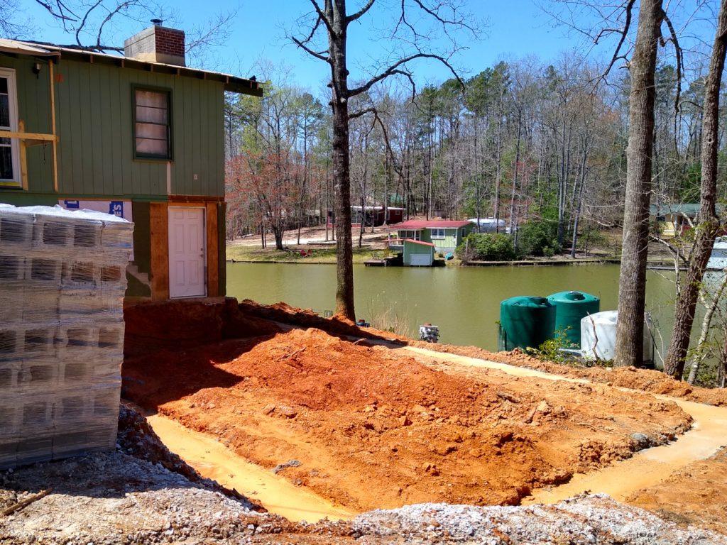 Footer trench filled with concrete. Lake Becky in background
