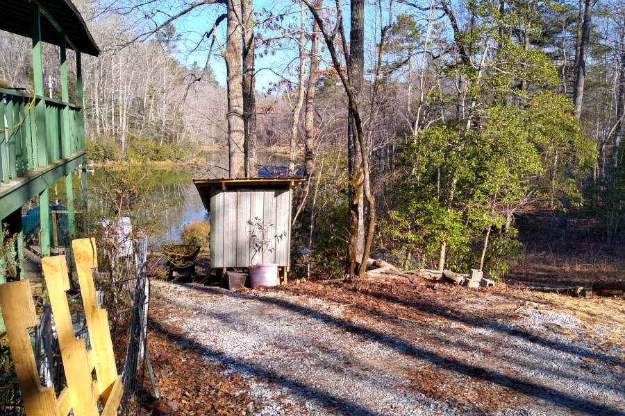 Wood shed and rotten erosion control logs