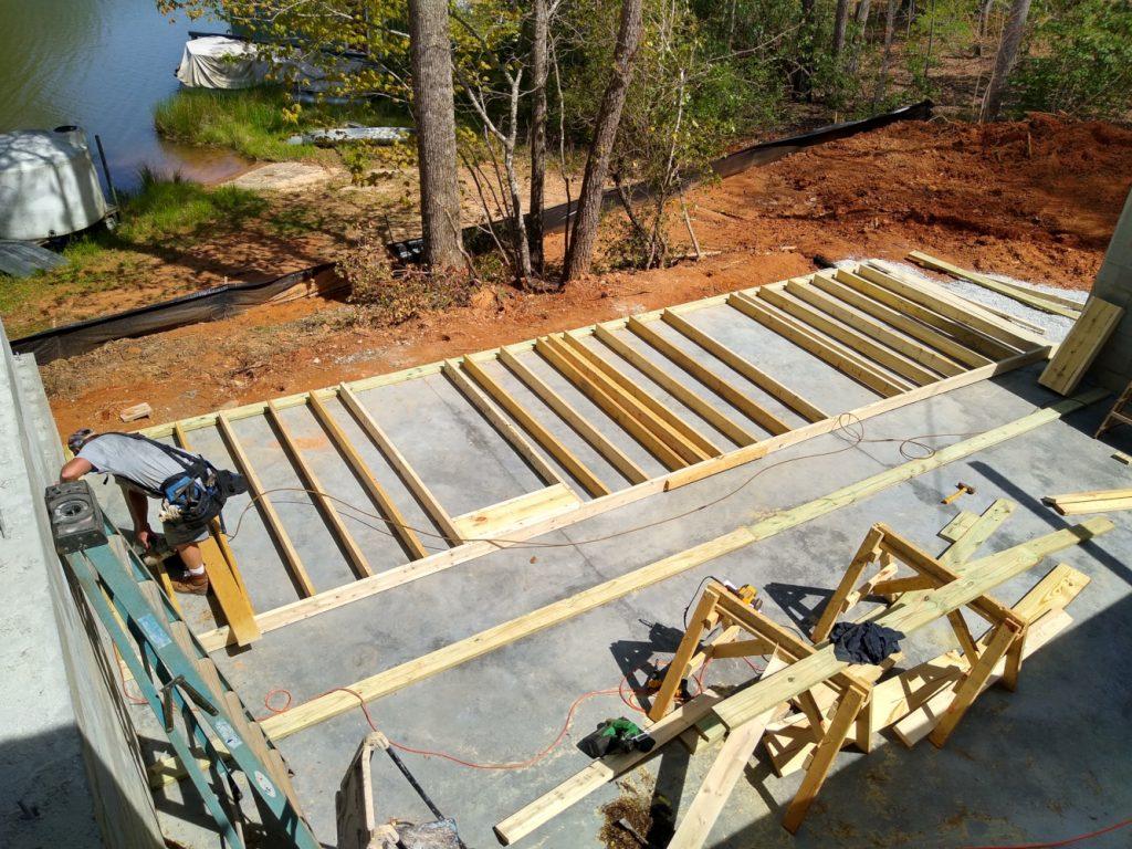 Framer building the first basement stud wall