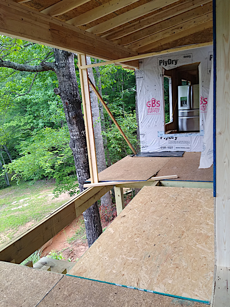 Balcony and front stairs still under construction