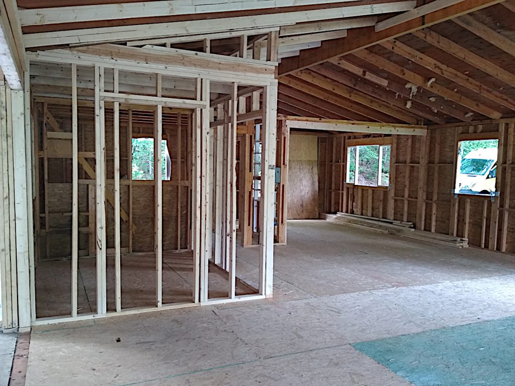 View through living room, kitchen, and pantry toward southwest corner