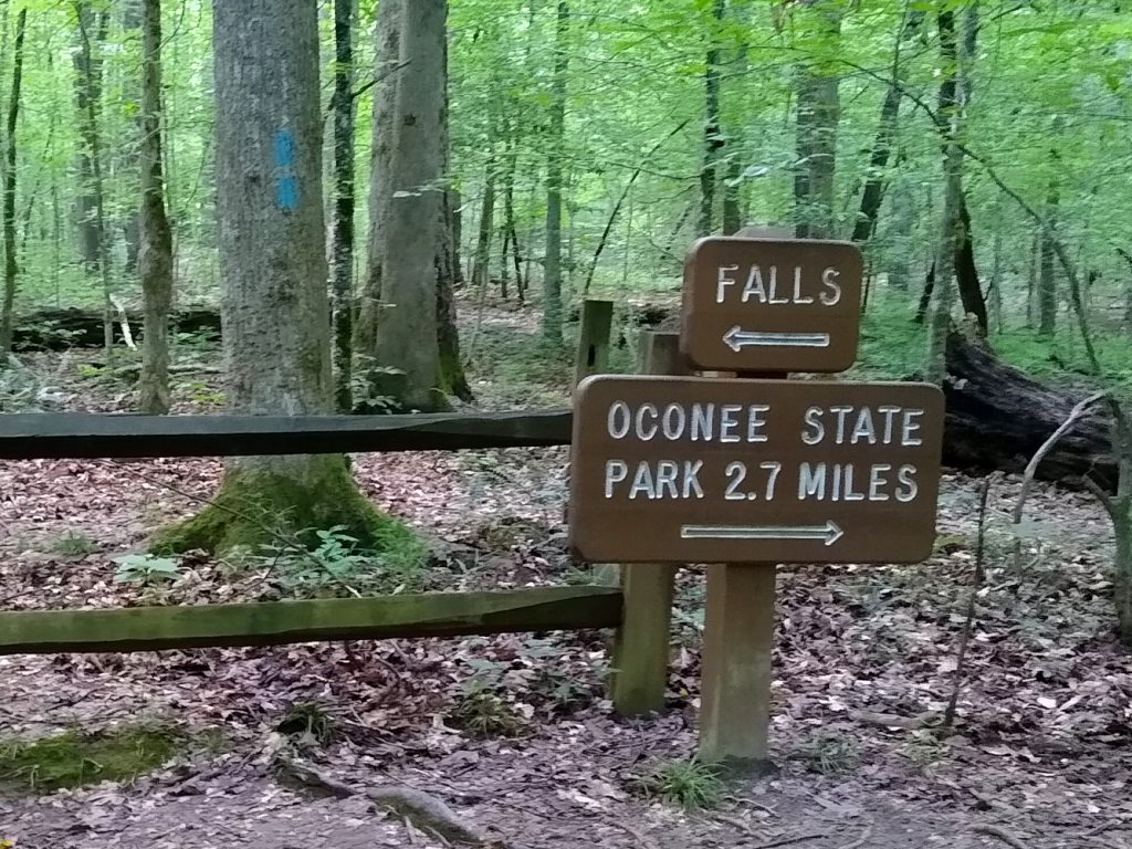 Sign pointing to falls and Oconee State Park in opposite directions