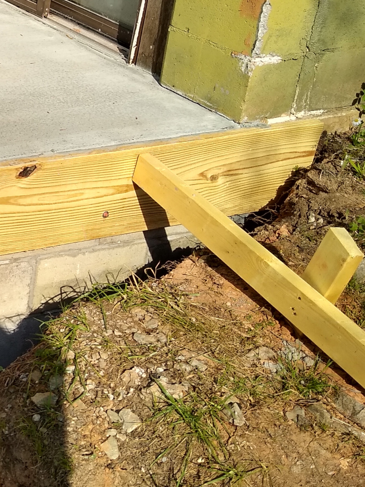Detail of Patio foundation under existing house corner