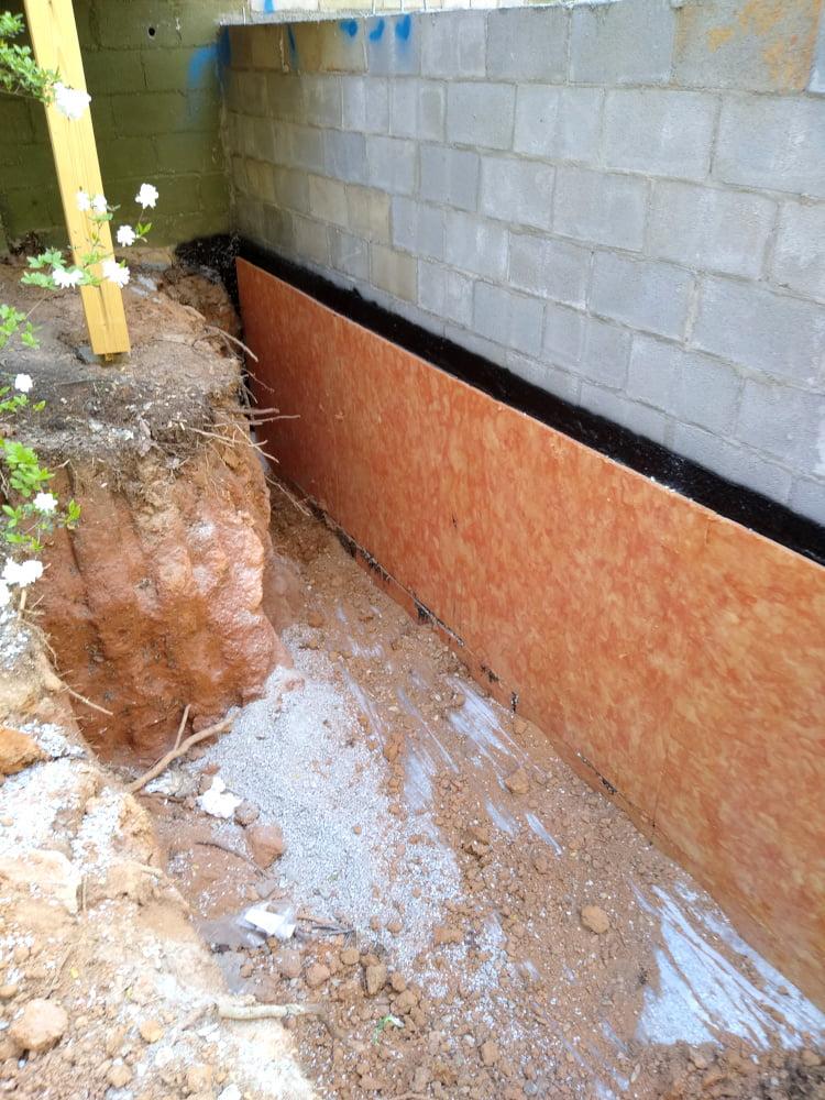 Basement wall waterproofing - soutwest corner