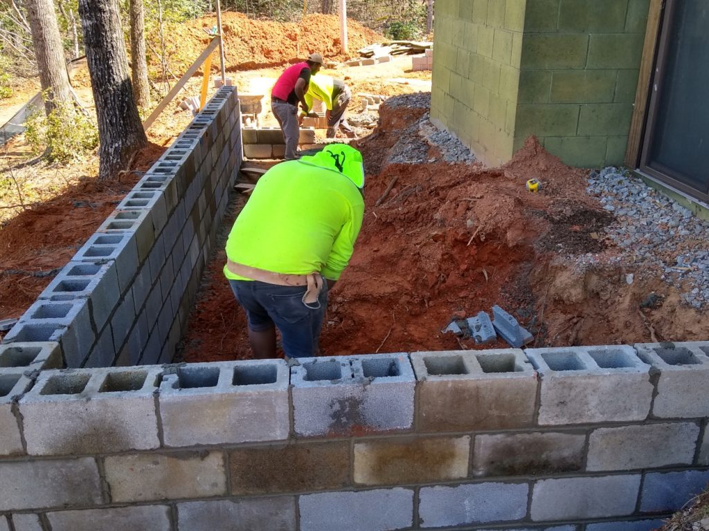 Patio retaining wall in work